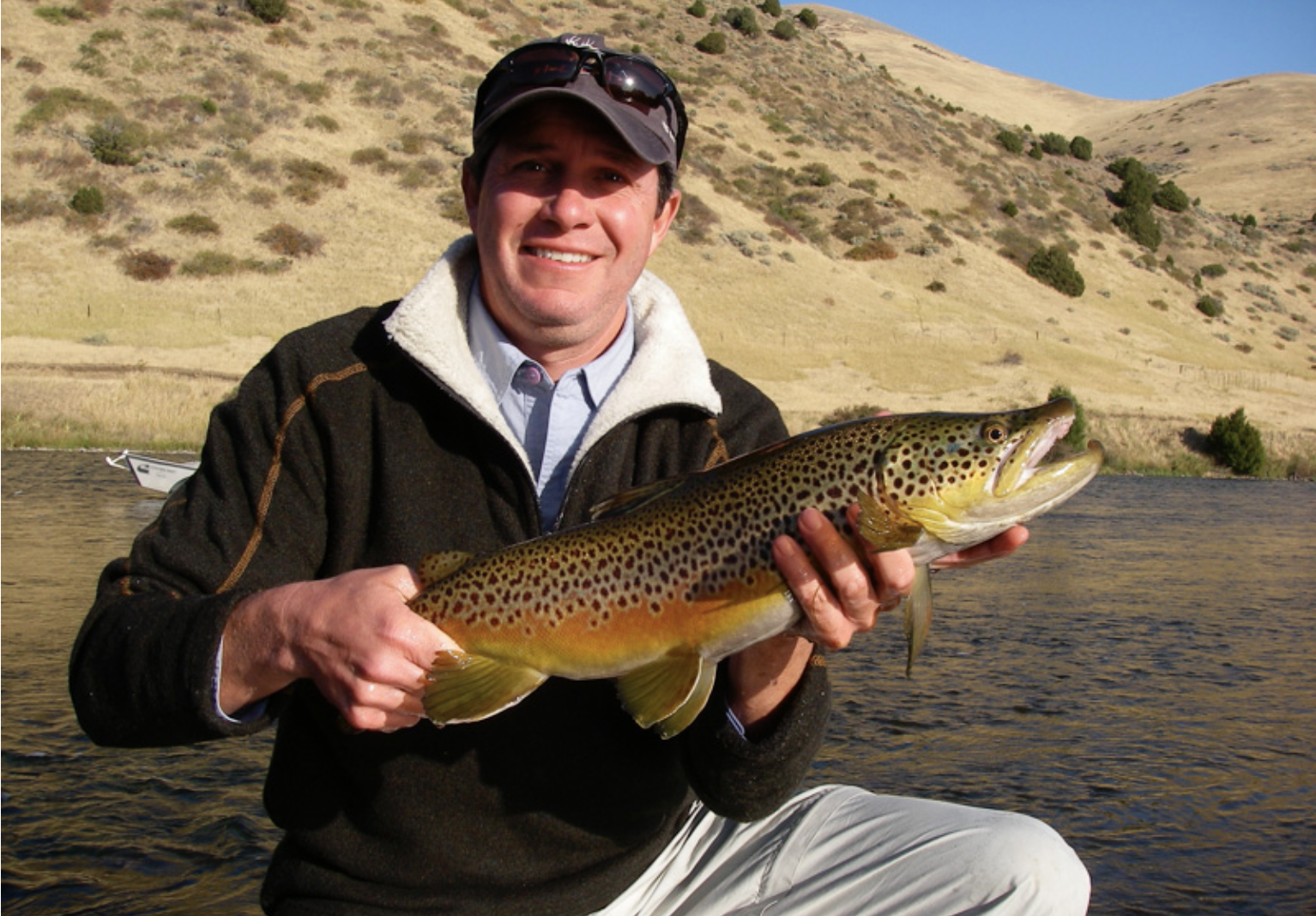 Fins & Feathers of Bozeman fly shop and fly fishing guide service guest with a terrific Lower Madison river Brown Trout.